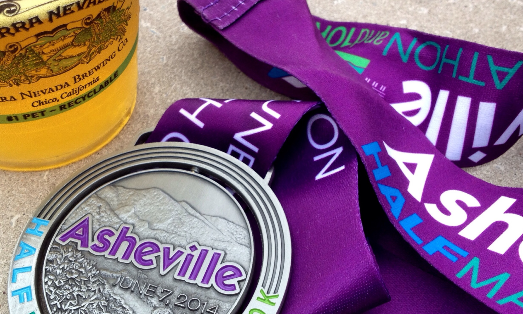 The Asheville Half Marathon was a buttkicker. So. Many. Hills. Totally earned the beer at the end.