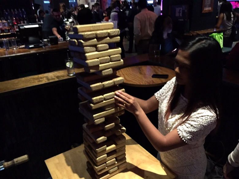 Intern #1 going for it at the giant Jenga.