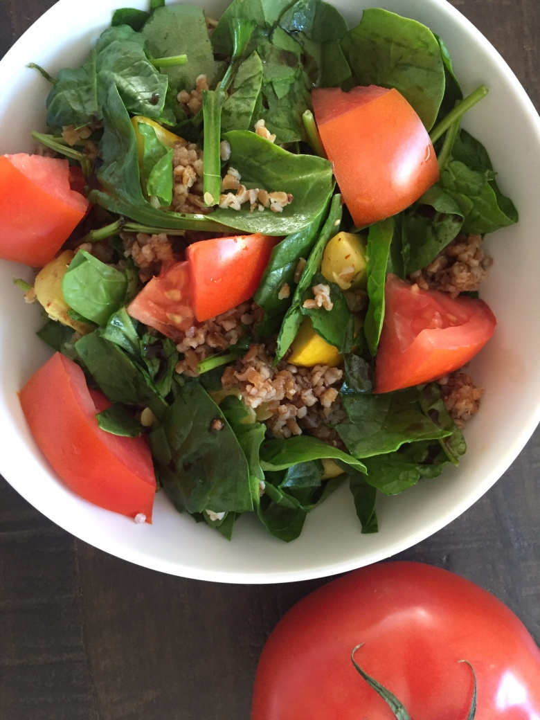Mix squash, peppers, bulgar, spinach, and tomatoes with balsamic vinegar. Then eat!